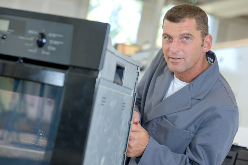 Oven Repairman working on electric oven repairs in Mt Clear and Mt Helen and local area